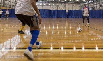 Students playing indoor soccer.